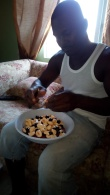 Gregory showing how to prepare ackee