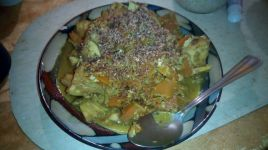 Dehydrated coconut seasoning on top of some curried pumpkin and cabbage